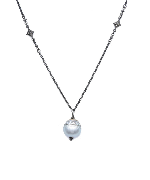 Carved Tahitian pearl on long chain