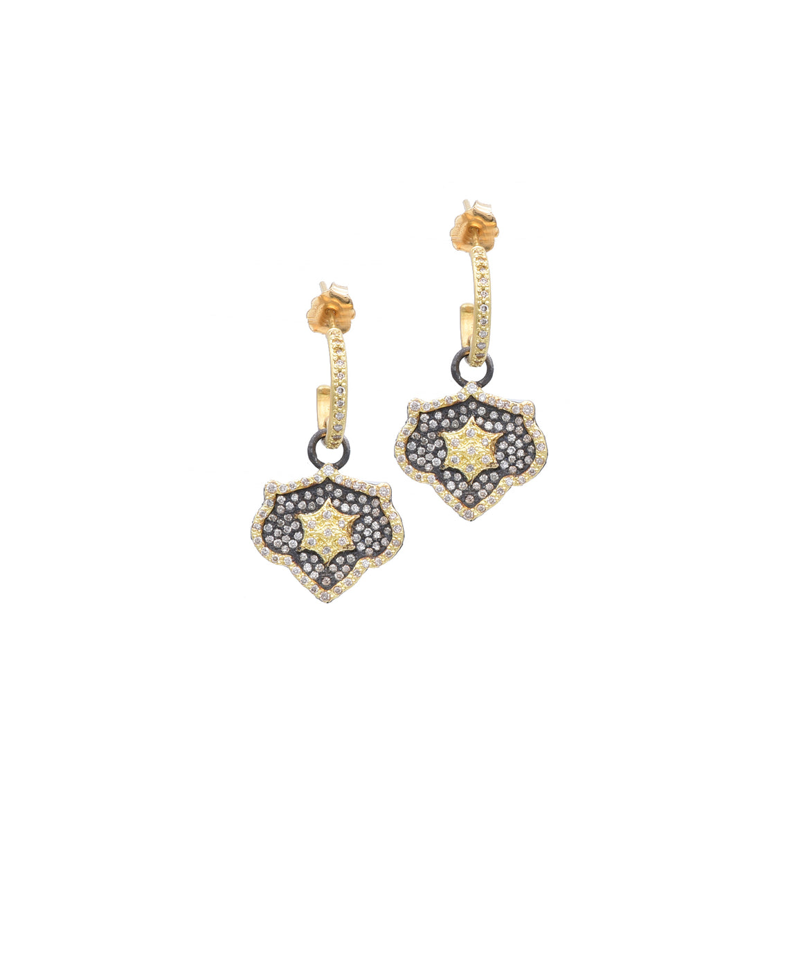 "The champagne diamond pavé shield drops swing from the huggie hoop tops. The 18k yellow gold and sterling silver earrings are 1 1/8"" long."