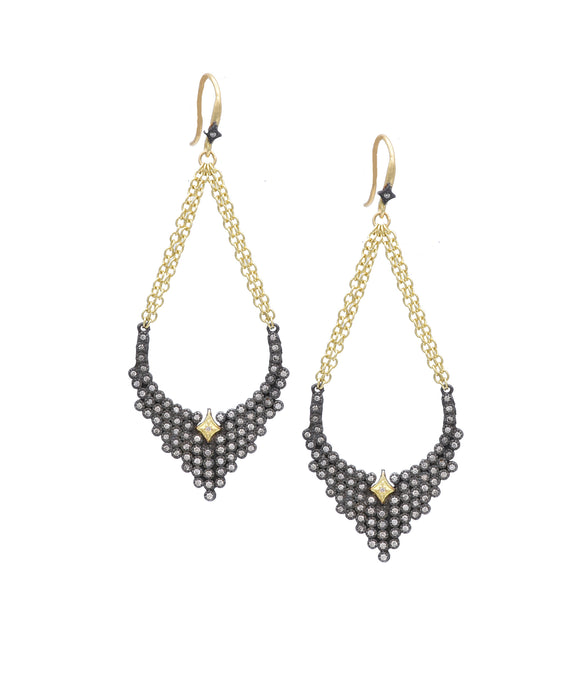 "These dramatic earrings suspend champagne diamond arcs from glittering gold chains. The 18k yellow gold and sterling silver earrings are 2 1/2"" long."