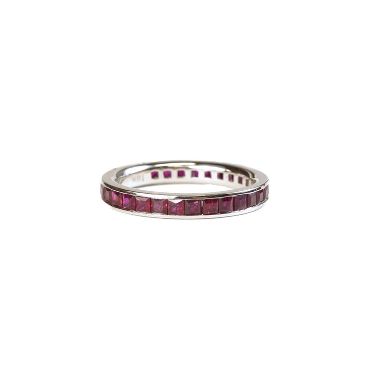 Eternity band with princess cut rubies