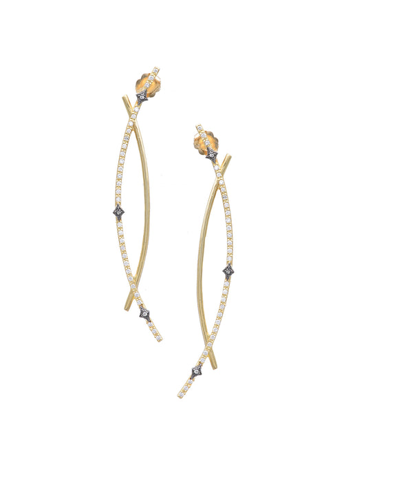 "The 18k yellow gold and sterling silver earrings feature opposing curved lines, one set with diamonds. The earrings are 2 1/2"" long."