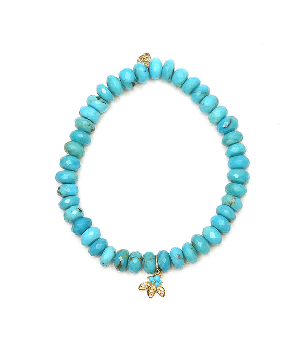 Turquoise bead bracelet with turquoise petal charm