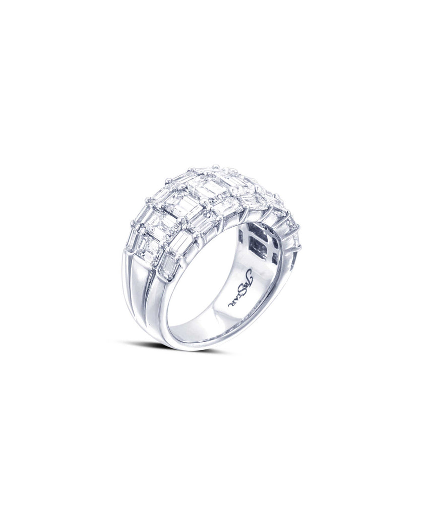 Wide three-row ring with emerald cut diamonds
