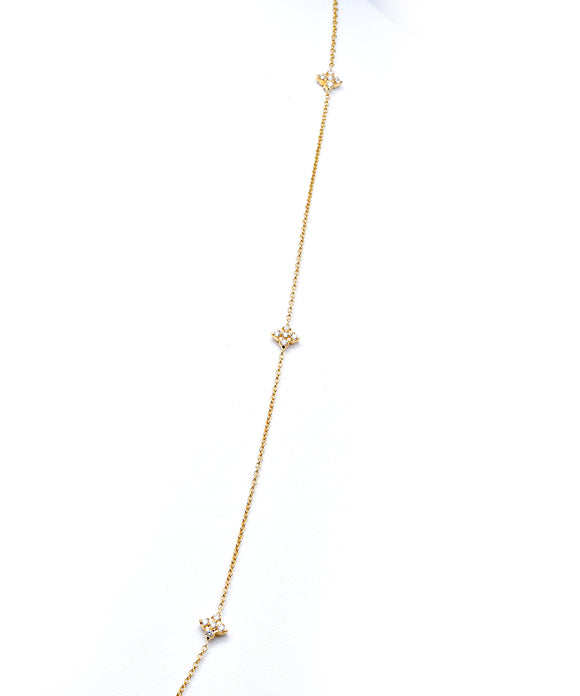 Diamond flower necklace in yellow gold
