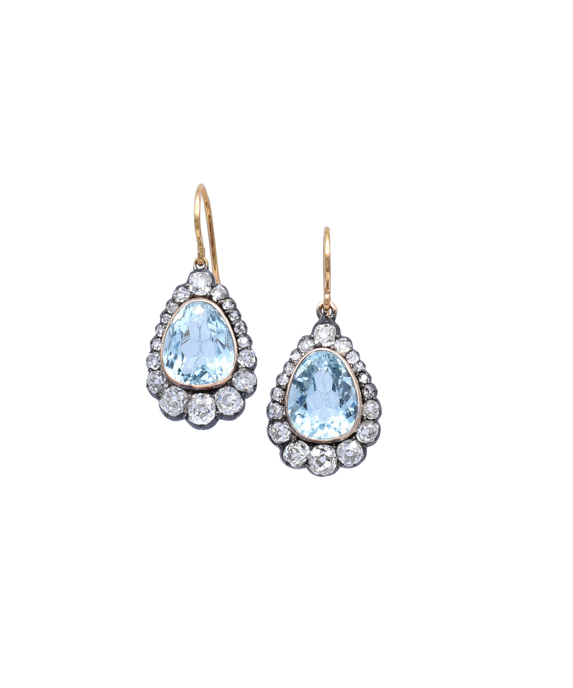 "The limpid blue aquamarines are highlighted by sparkling diamonds in these lovely vintage earrings. The silver and gold pear-shaped drops are about 1 1/8"" long."