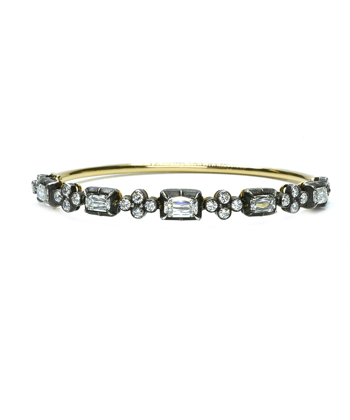 Bangle bracelet with emerald cut diamonds