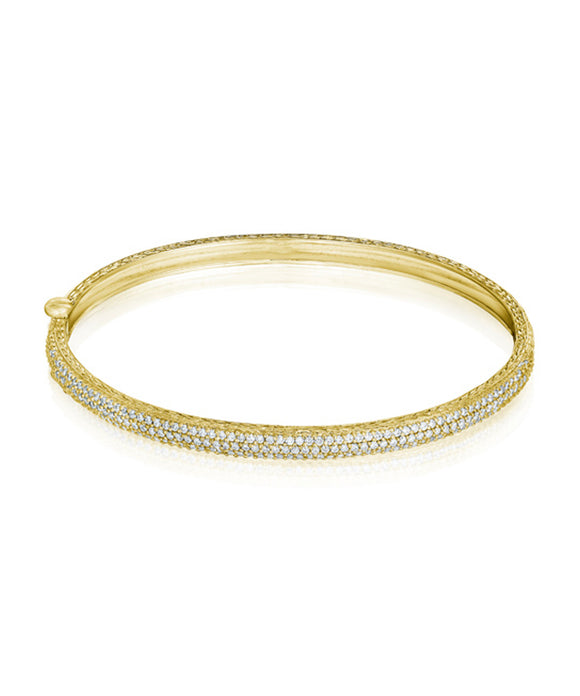 Rounded bangle in yellow gold