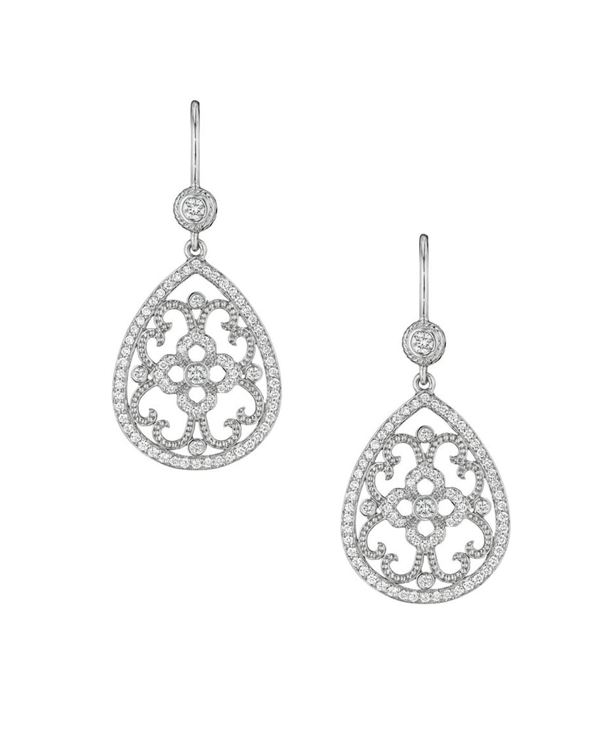 Open lacy earrings in white gold