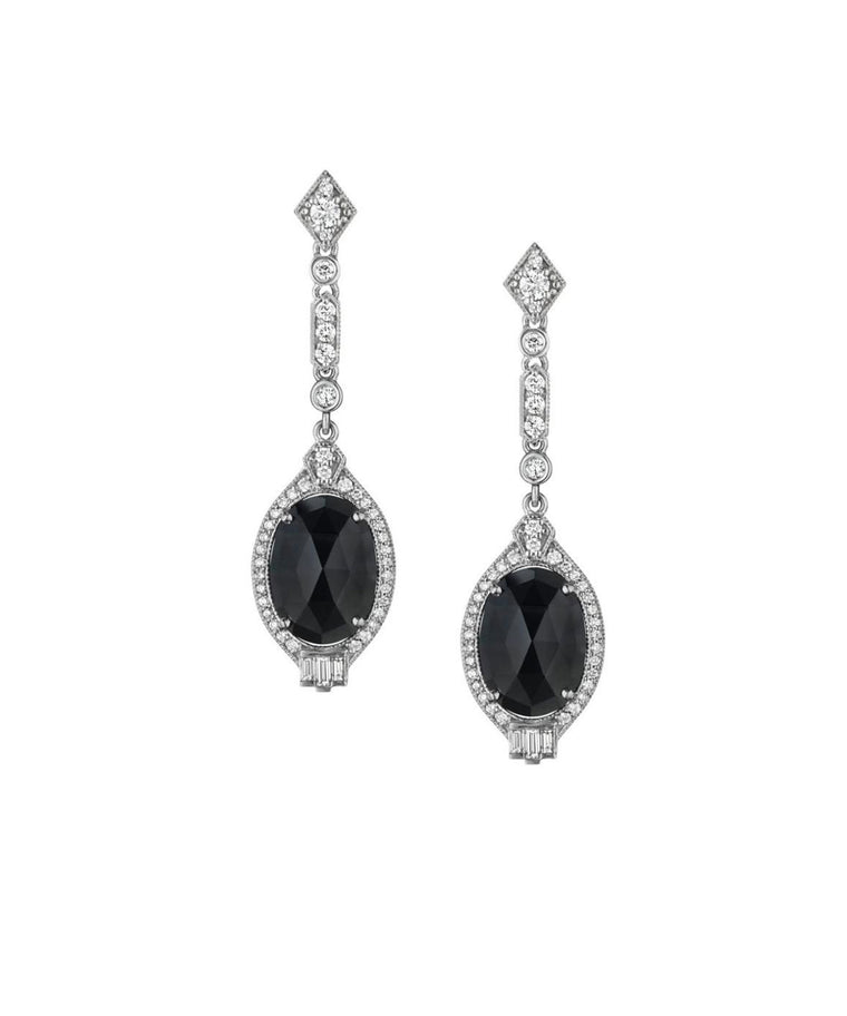 "The classic combo of black-and-white never looked better than in these Deco-inspired earrings. The 18k white gold drops earrings are set with round and baguette diamonds diamonds totaling 1.09 carat, as well as faceted oval black spinels. The earrings are 2"" long."