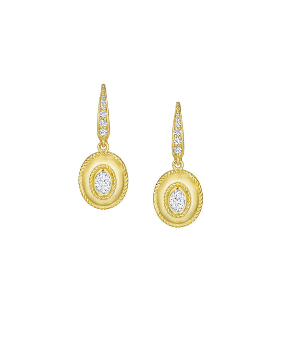 "The rich matte finish sets of the sparkling oval diamonds in these drop earrings. The oval diamonds total .62 carat; the diamond pavé totals .17 carat. The 18k yellow gold earrings are 1 1/8"" long from the top of the hinged wire back."