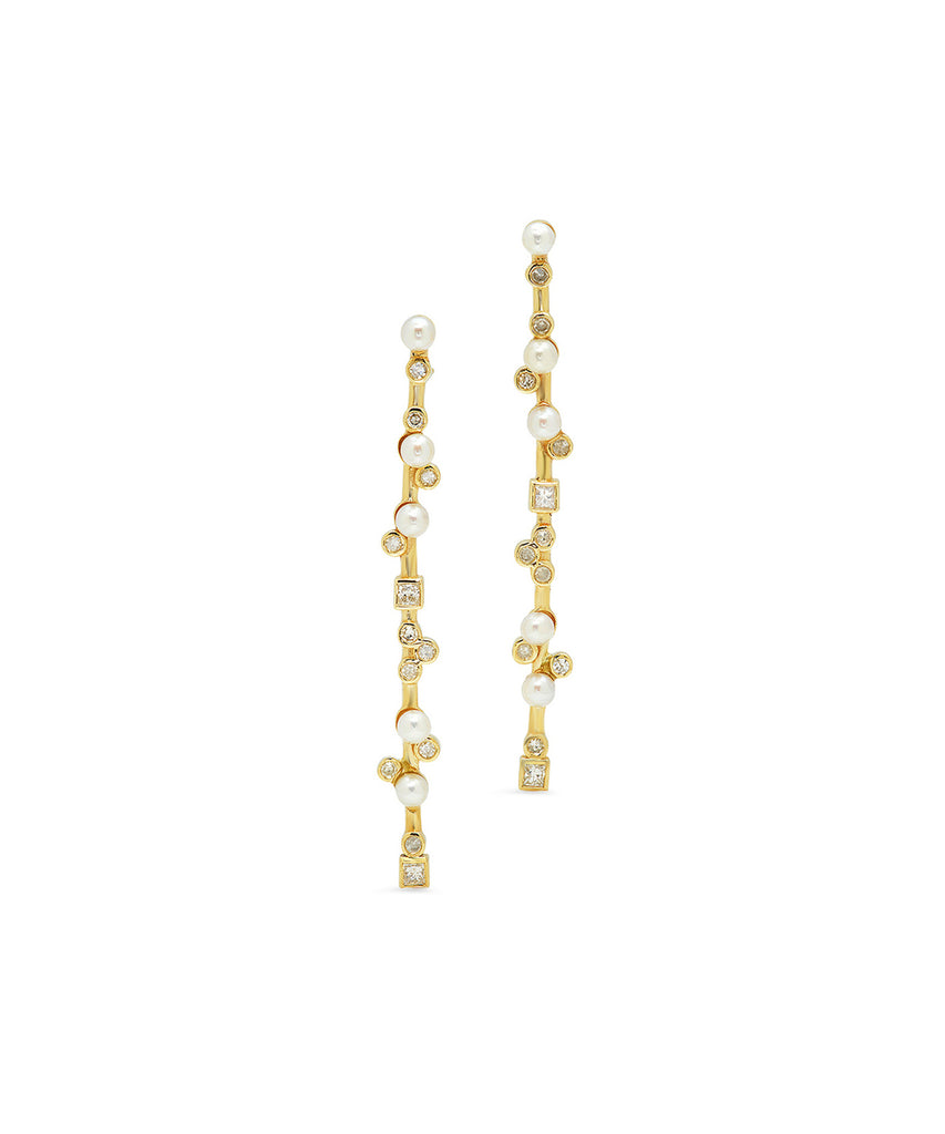 "Bezel-set diamonds mix with lustrous pearls for these graphic earrings. The 18k yellow gold stick earrings are 2"" long and finished with posts and backs."
