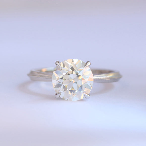 Laurel solitaire mounting in platinum