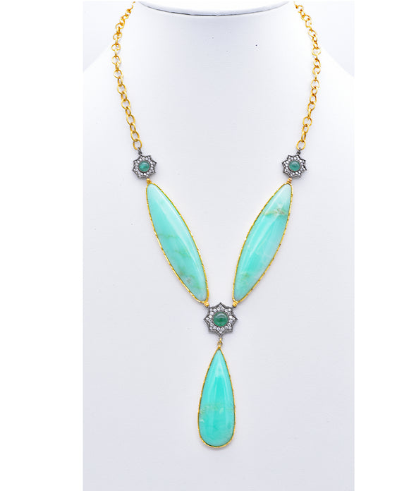 "Not for the shy! This amazing necklace has three segments of lush chrysoprase set in 22k gold. Joining them are sterling silver rosettes set with sparkling diamonds and bright emerald cabochons. The pear-shaped bottom segment is 2 1/4"" long. The necklace itself is 20"" long with a 3"" drop."