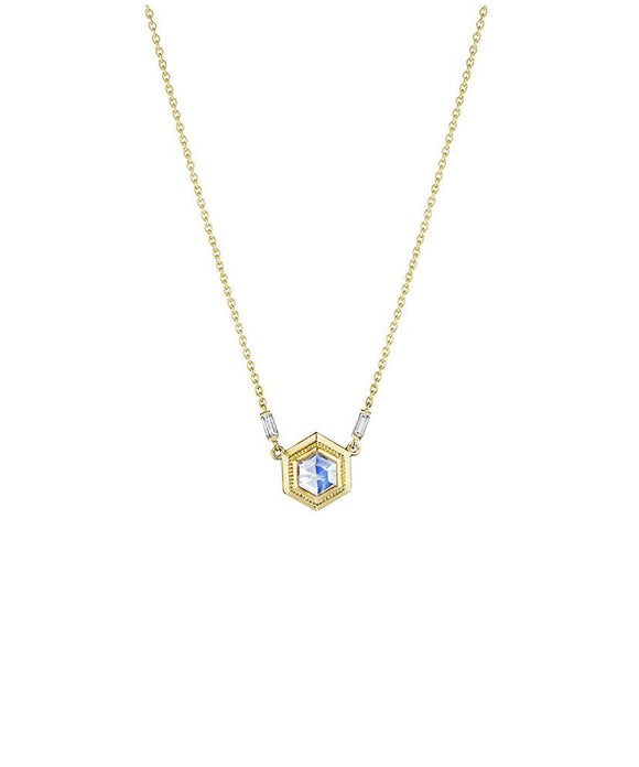 "Set in a detailed hexagonal frame, the faceted moonstone glows.The 18k yellow gold necklace is accented with baguette diamonds totaling .28 carat. The hexagon is 1/2"" wide and hangs from an 18"" chain."