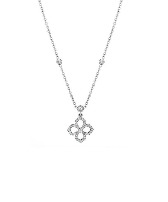 "This charming little flower necklace is set with diamonds totaling .33 carat. The flower is 5/8"" across and is suspended from a 15""-16"" adjustable chain."