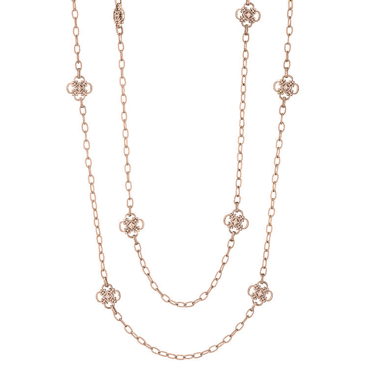 "This 34"" chain necklace is a lovely deep shade of rose gold. The intricate flower stations are set on both sides with diamonds, .64 cart in total. Layer away!"