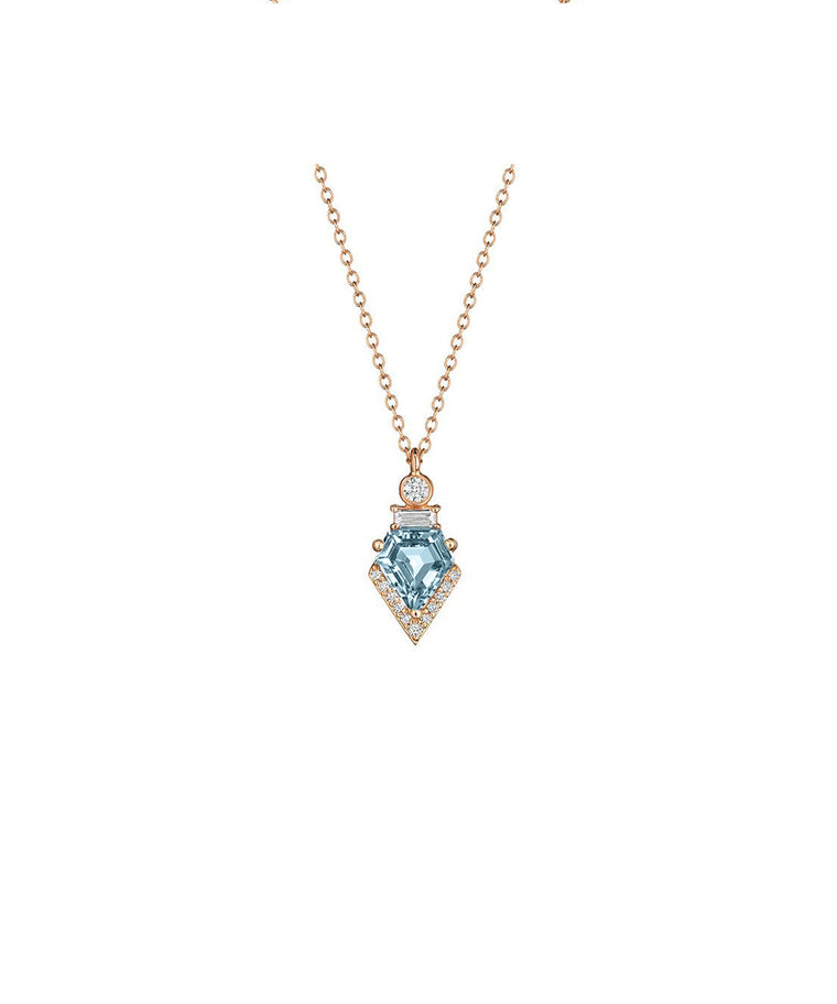"A 1.01 carat shield-cut aquamarine shines in this 18k white gold pendant. Round and baguette diamonds total .84 carat. The pendant is a petite 5/8"" long and suspends from an18"" fine link chain"