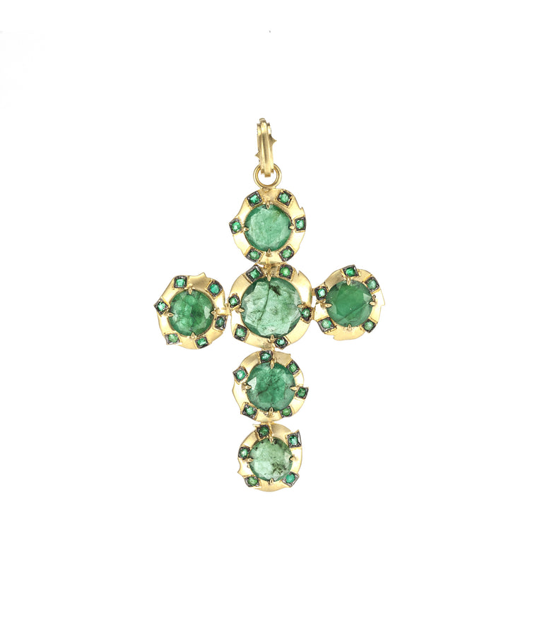"This cross has an archaic look, but it's a new treasure. The 18k handmade  cross has a matte finish and  set with 14.90 carats of Brazilian emeralds. 1.03 carat of Zambian emeralds are set around the larger emeralds. The cross is 3"" long including the hinged bale."