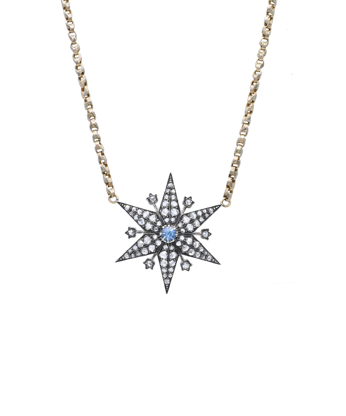 "The subtle sparkle of old-cut grey diamonds adds a sophisticated edge to this vintage starburst . It's centered by a bright blue sapphire. The silver-over-gold star is 1 1*/4"" across and hangs from a vintage 16"" watch chain."