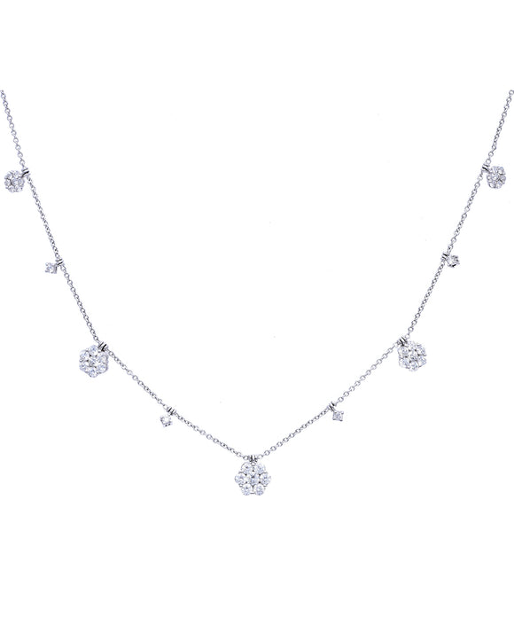 "This charming necklace features three diamond flower pendant for a breezy look. Total diamond weight is 1.78 carat. The 18k white gold necklace is 16"" long."