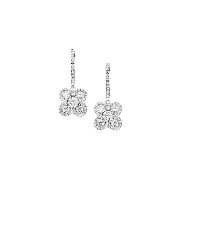"The diamond flowers swing from a huggie top for these 18k white gold earring. The flowers are about 3/8"" across. Total diamond weight is 1.30 carat."