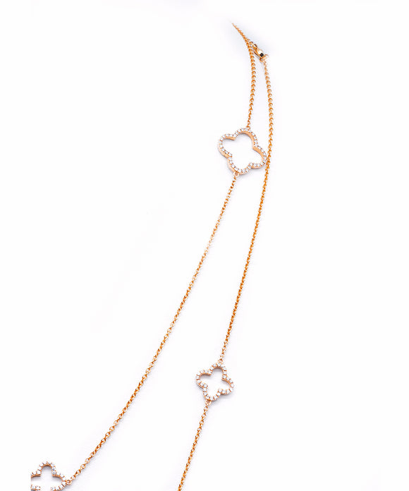 "This fun necklace is 48"" long, so you can double or even triple it! The 18k rose chain is set with alternating large and small clover stations, each set on both sides with glittering diamonds. Total diamond weight is 3.28 carats. The larger clover is about 5/8"" across."