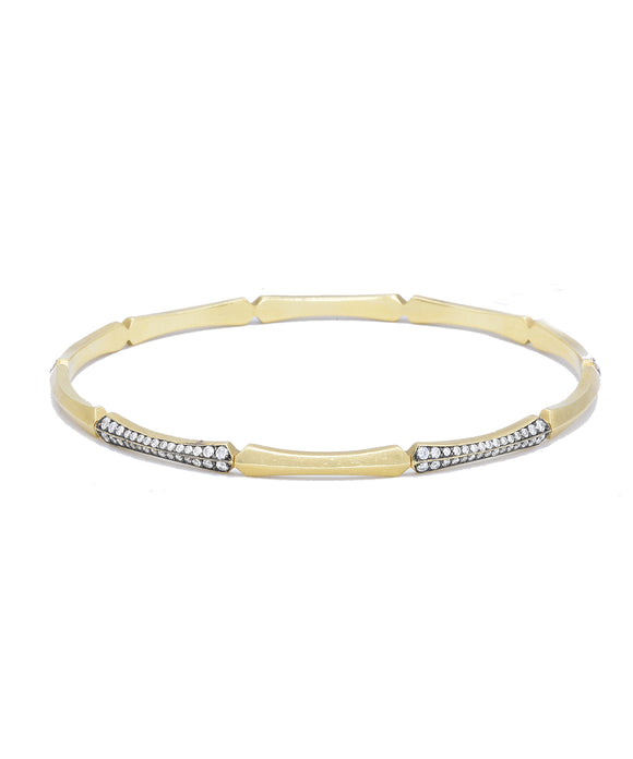 "Fun alone, and better stacked! The 18k yellow gold bangle bracelet is set with brilliant diamonds totaling 1.20 carat. The round bracelet is  2 1/2"" in diameter"