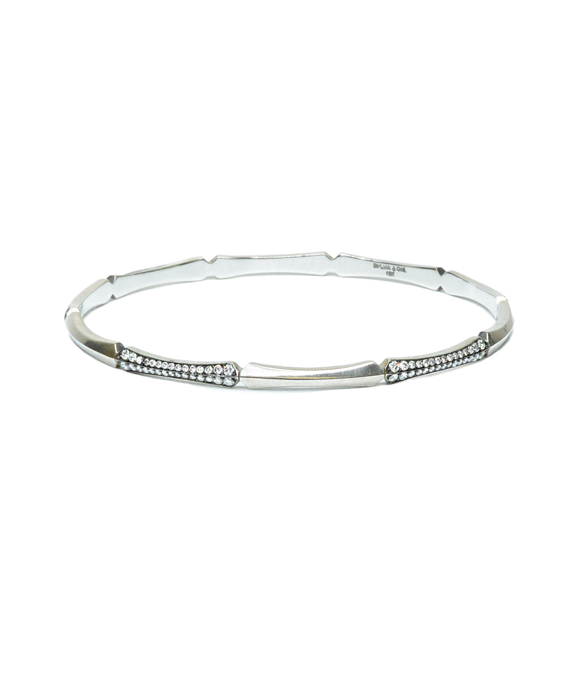 "Fun alone, and better stacked! The 18k white gold bangle bracelet is set with brilliant diamonds totaling 1.20 carat. The round bracelet is  2 1/2"" in diameter"