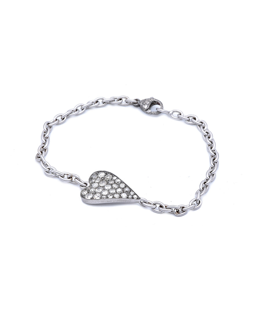 "The 18k white gold and sterling silver bracelet features a Ten Table heart set with 1.30 carat of Old European cut diamonds. The heart is 3/4"" long. The bracelet is 7"" long in total."