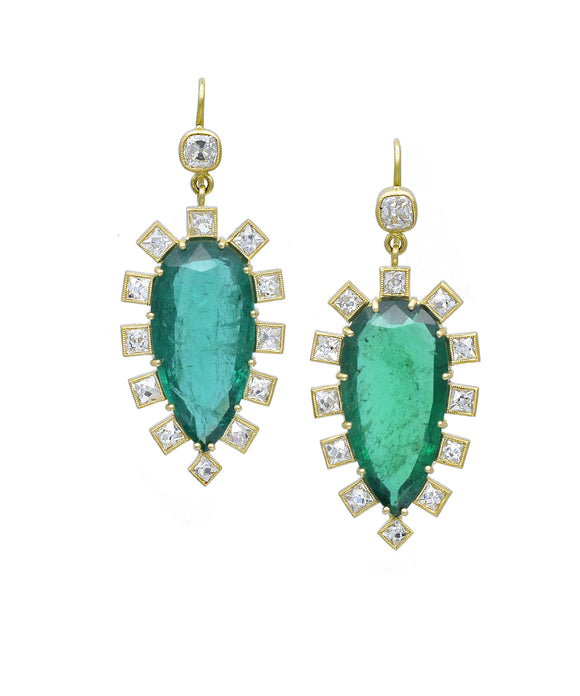 "You've never seen anything like these incredible new earrings by Sylva. The pear-shaped Zambian emeralds total 27.98 carats. They are embellished with French cut diamonds totaling 5.02 carats. Topping everything are cushion-cut diamonds weighing 1.08 carats. The 18k yellow gold drops are about 2"" long."
