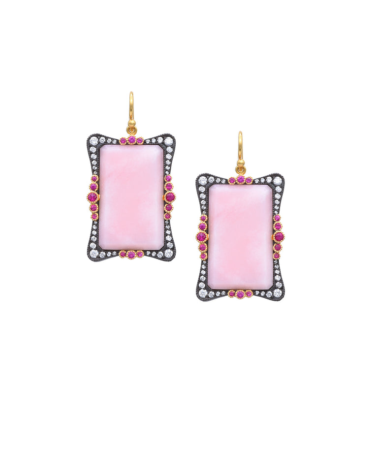 "Framed by sparkling diamonds totaling .85 carat, the luminous pink opals cast a spell. The 22k gold and sterling silver earrings add rubies to the mix for contrast. The earrings are 15/8"" long."