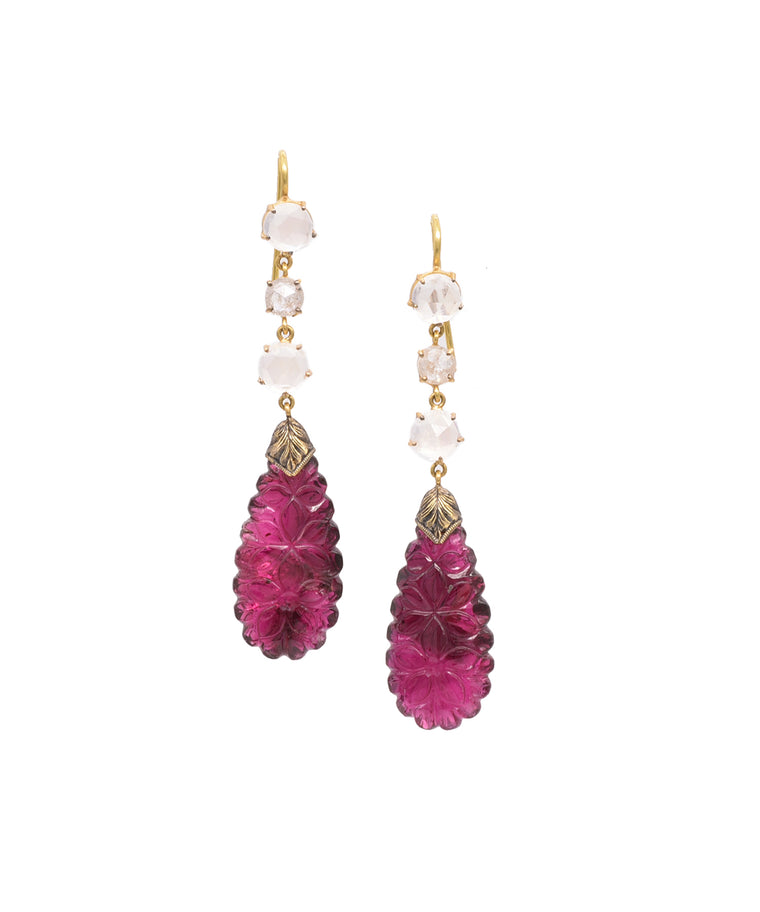 Earrings with carved tourmaline