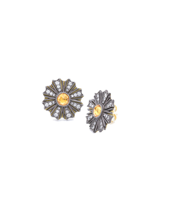Sunburst stud earrings with yellow sapphire