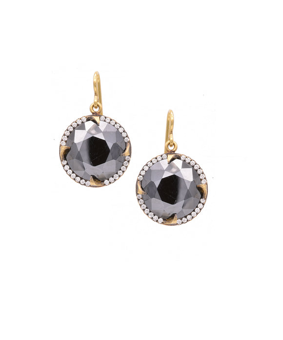 "The highly polished hematite sparks with light. Set in 18k yellow gold, the stones are ste with .50 carat of round brilliant diamonds. The earrings are 1"" long from the top of the wire."