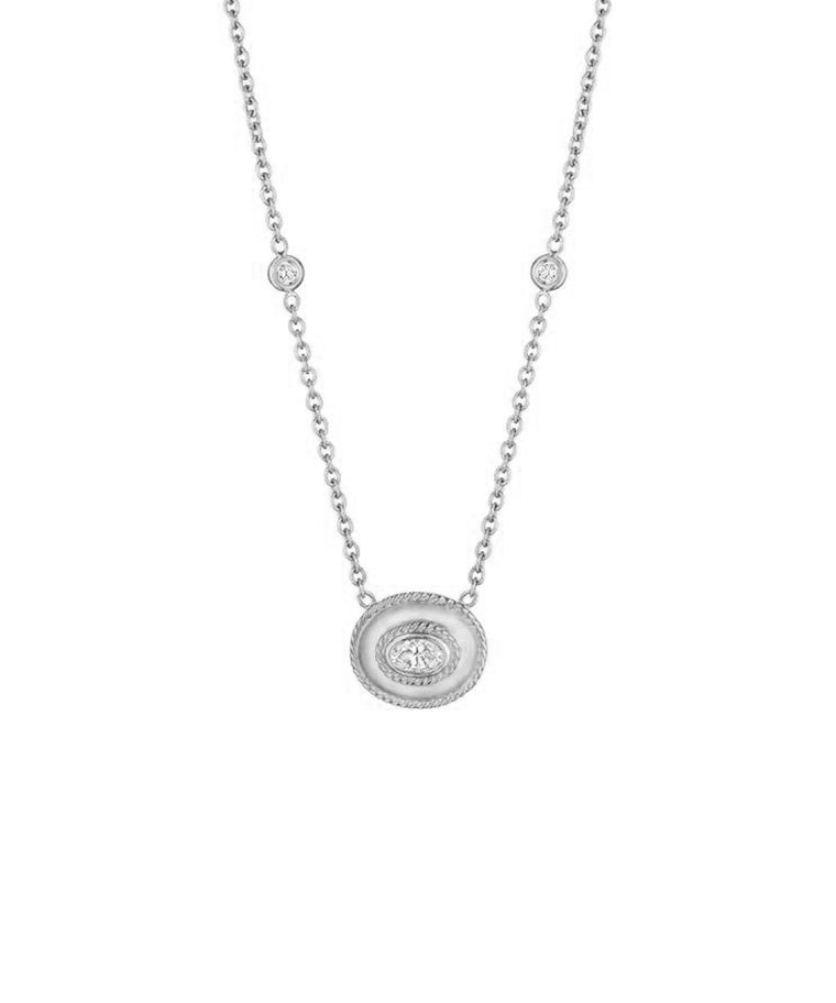 "The .41 carat oval diamond is set crosswise in a polished 18k white gold frame.The frame is detailed with milgrain. The pendant is 1/2"" across and hangs from an 18"" chain."