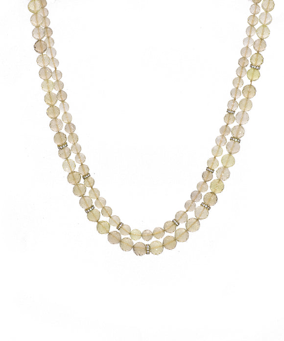 "The citrus tones of lemon quartz make a versatile necklace to wear with a lot of things. The graduated beads are finely faceted. The largest is 9 mm in diameter. 18k yellow gold rondels are set with single-cut diamonds for sparkle. The necklace is 22"" long."