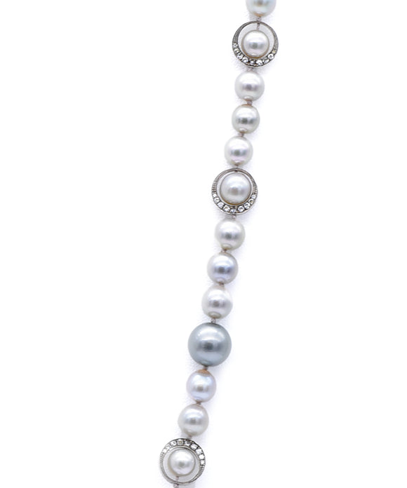 Pearl strand with diamond crescents
