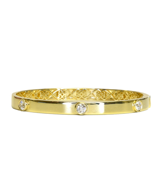 Polished hinged bangle with diamonds