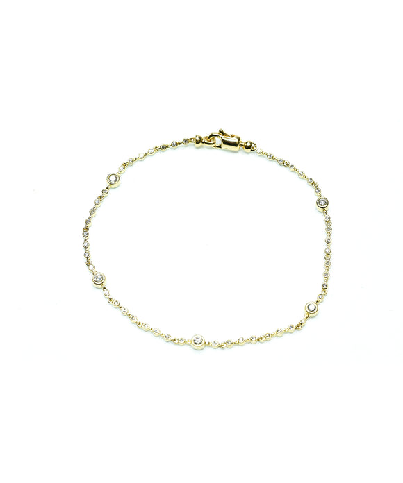 Yellow gold bezel diamond bracelet