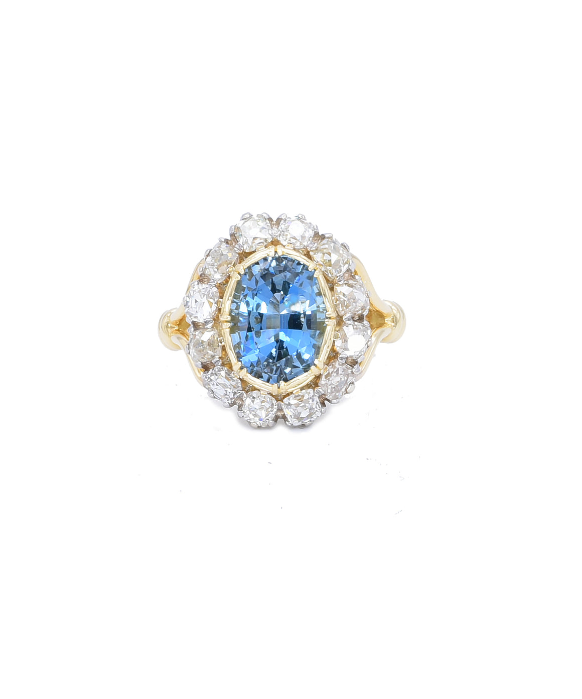 "You just don't see aquamarines with a color this intense anymore. The oval 3.28 carat aquamarine is from a mine that no longer produces. It is surrounded with Old Mine cut diamonds totaling .95 carat. We've set the gems in a modern 18k two-tone settings. The ring is 11/16"" tall and size 6."