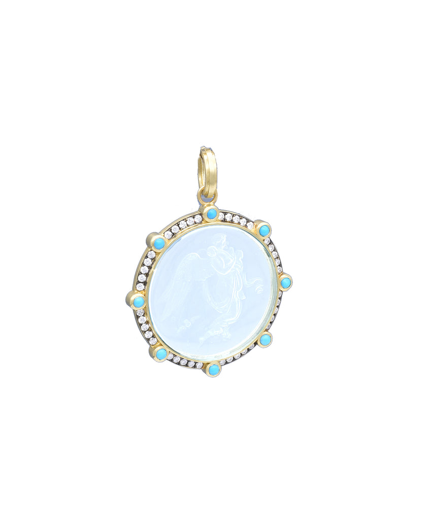 Antique crystal intaglio in turquoise bezel