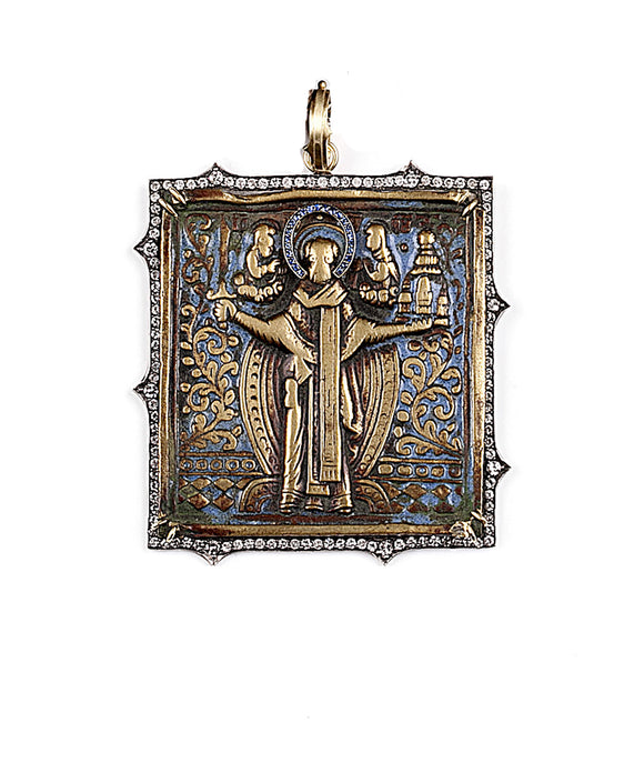 "The antique bronze icon of St. Nicholas still has traces of its original enamel. Sylva has added the sapphire halo, and set the icon in an 18k yellow gold frame. Brilliant and single-cut diamonds total 2.22 carat. The icon is about 3"" long including the hinged bale."