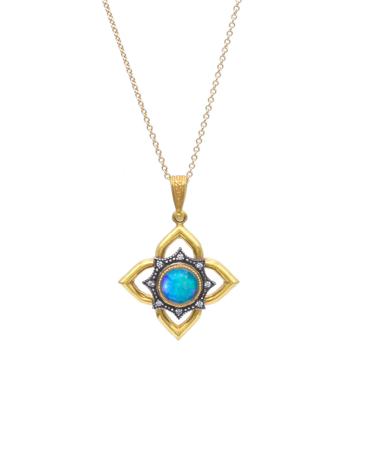 "The flower pendant is crafted in 22k gold. It is set with a sterling silver diamond-set flower centered with a colorful opal. The flower is 1"" across and hangs from a 16"" gold chain."