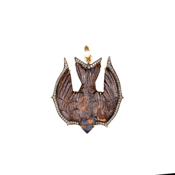 "You'll discover flashes of color in the highly detailed hand carved opal swallow. It's set in a framed of 18k yellow gold with sparkling Old European cut diamonds totaling 1.30 carat. The pendant is 2 1/2"" long including the hinged bale."