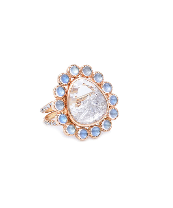 "The 1.44 carat of diamonds captured between panes of white sapphire dance with every move of your hand. The 18k rose gold ring is trimmed with luminous moonstones for a lovely contrast. The front of the ring is about 7/8"" tall."