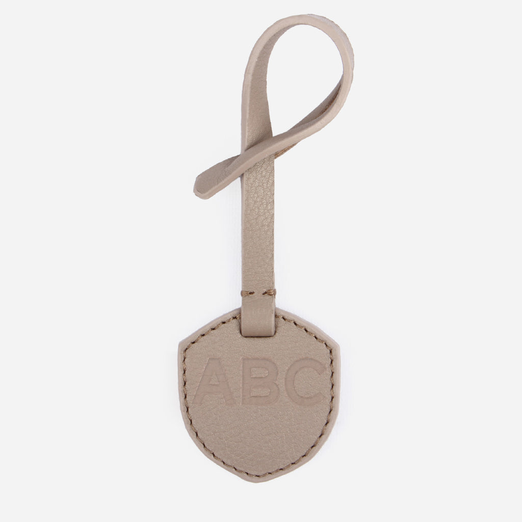 Monogram Tag -  branded debossed taupe leather accessories tag  - Poppy Barley