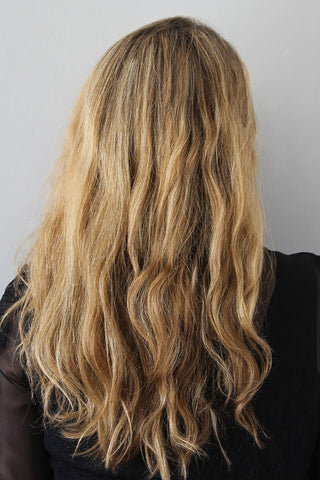 he Easy Twisted Half-Up Hairstyle for Wavy Hair Step1