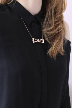 Plated brass bow barrette in rose gold plated finish worn as pendant