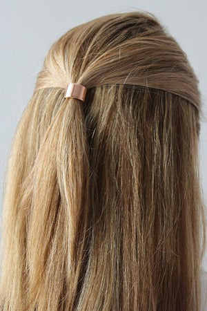 Little Classic Pony Cuff worn around a half ponytail in rose gold plated brass