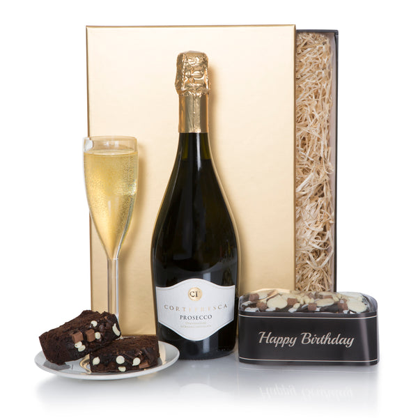 A gift that will be well received by the birthday celebrant. This is an ideal and practical Birthday Gift. Includes: ONE (1) Cortefresca Prosecco 75cl, ONE (1) Gold Crown Decorated Happy Birthday Chocolate Cake. Presented in a Gold and Black Lidded Box. Your satisfaction guaranteed 100%. Your gift message included! WE DISPATCH THIS GIFT FROM OUR UK FACILITY FOR RECIPIENTS IN EUROPE, THE UK AND IRELAND. Value Added Tax (VAT) is Included. DUE TO GOVERNMENT REGULATIONS WE CANNOT DELIVER IN NORWAY.